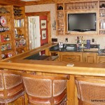 custom-bar-with-sevice-hinged-lift-up-wood-bar-top-is-accented-by-these-ratan-back-bar-stools-which-add-to-the-comfort-of-this-warm-cozy-feeling-bar