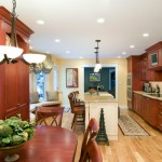 custom-maple-stained-kitchen-with-glazed-ivory-island-and-whitehaus-fireclay-farm-sink