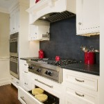 custom-pietra-cardosa-granite-countertops-backsplash-manchester-by-the-sea-ma-with-wolf-warming-drawer