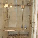 custom-shower-with-steam-body-sprays-stone-tile-floor-matching-border-shivikashi-granite-seat