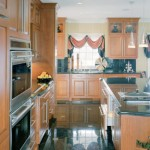 stained-cherry-cabinets-atlantic-black-granite-andover-kitchen