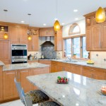 stained-maple-kitchen-giallo-veneziano-granite-with-a-stainless-steel-tile-diamond-shape-backsplash