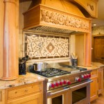 wolf-48-range-with-dbl-ovens-swampscott-custom-hood-with-hand-carved-onlays