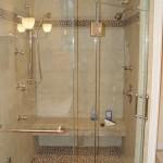 Custom Shower with Steam, body sprays, Stone Tile Floor & matching border & Shivikashi Granite Seat