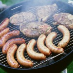 Grilled meat on barbecue grill --- Image by © Royalty-Free/Corbis