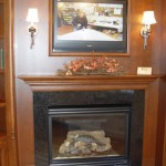 Natural Gas Fireplace with Granite Surround. Stained Custom Cherry Surround with multi layer custom moldingsadds tremendous beauty & appeal to everyone.