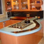 Custom Dyed Concrete Countertop with Absolute Black Granite Inlay , Custom shape Mahogany Solid Wood with matching contour Contemporary High Gloss Cabinetry