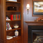 Custom Cherry Bookcase flanks this fireplace so you can gather your favorite book & glass of Port Wine, Crank up the fireplace. Sounds cozy!  I'll bet that will taste as good as it sounds